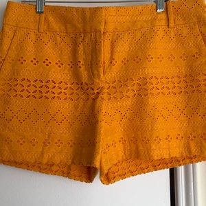 Bright tangerine colored shorts